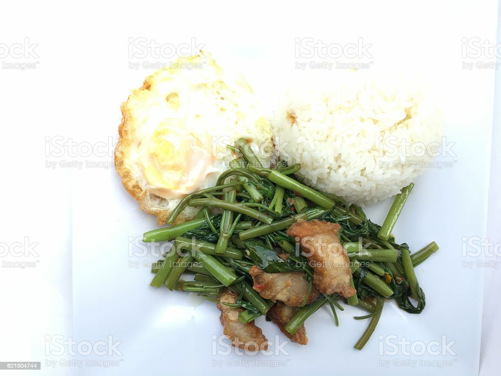 Stir Fried Water Spinach with chili and crispy pork photo libre de droits