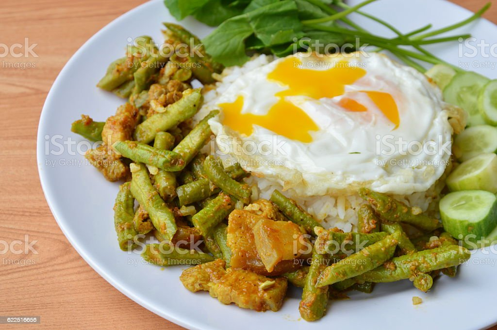 stir fried yard long bean with pork curry and egg stock photo