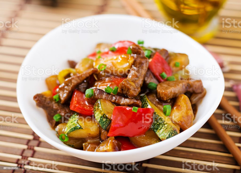 Stir fry beef, sweet peppers, zucchini and green apples stock photo