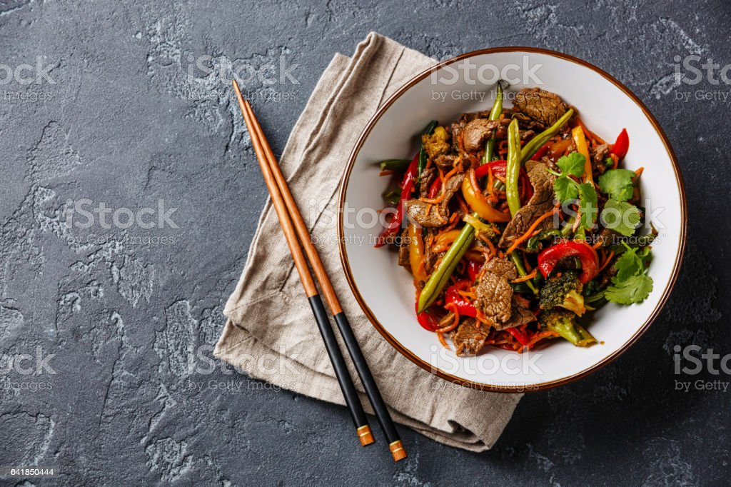 Stir fry beef with vegetables in bowl stock photo