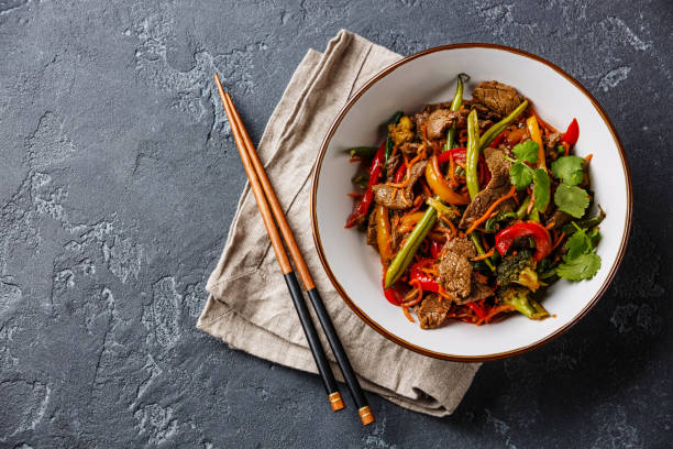 stir fry beef with vegetables in bowl - beef stock pictures, royalty-free photos & images