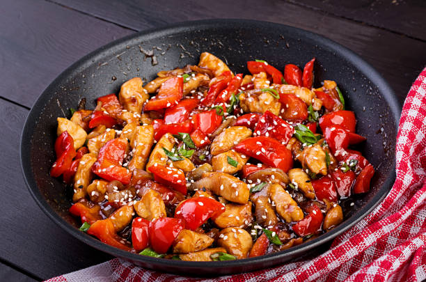 Stir fry chicken, sweet peppers and green onion. Asian cuisine stock photo