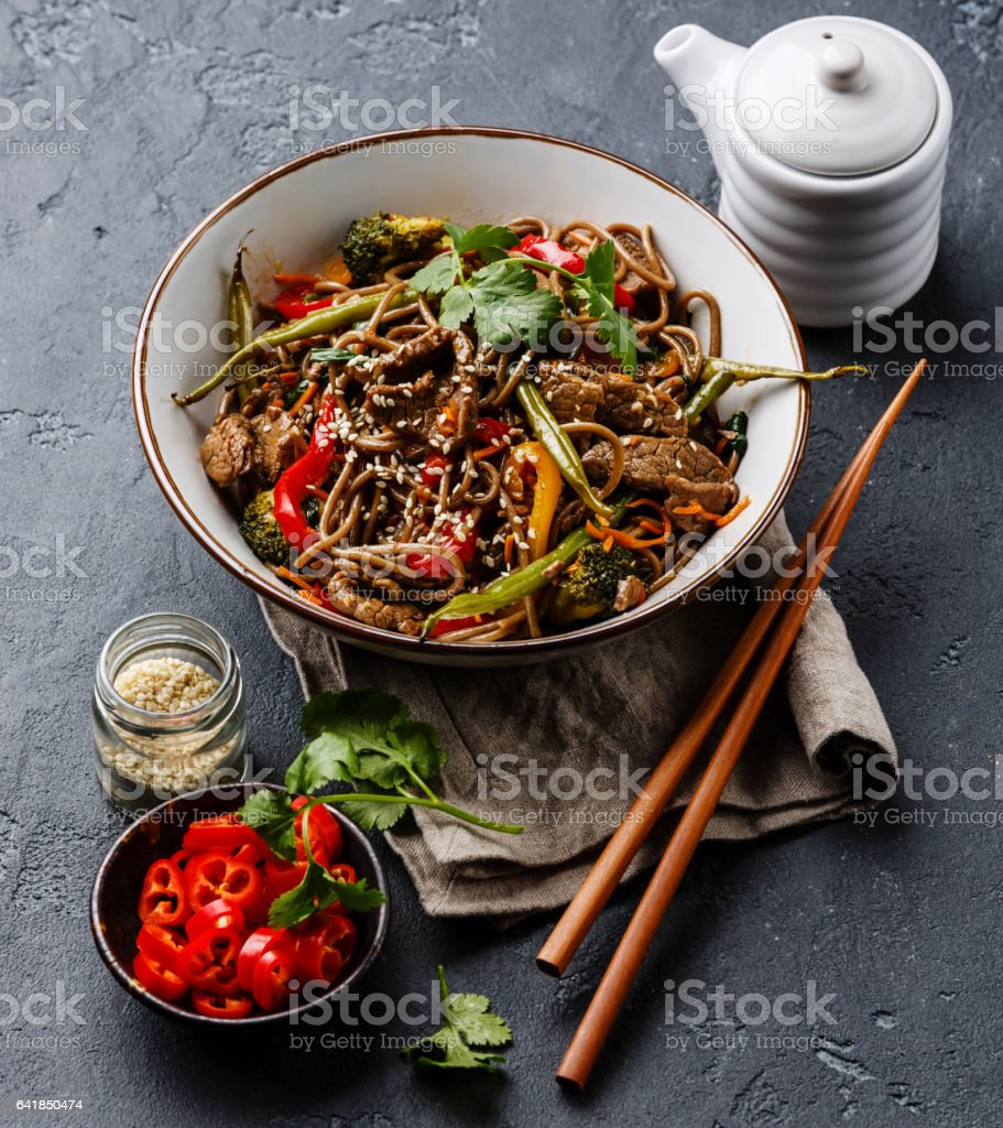 Stir fry noodles soba with beef and vegetables in bowl stock photo