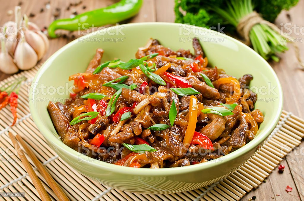 Stir fry pork, sweet peppers, onions and garlic stock photo