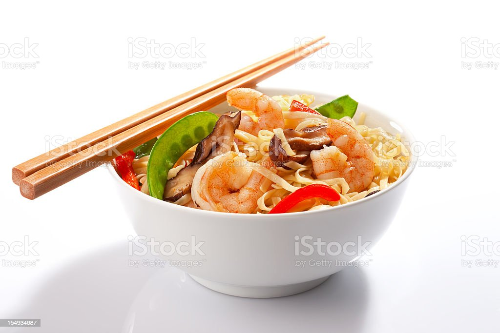 Stir-fried Asian noodles with prawns and chopsticks. stock photo