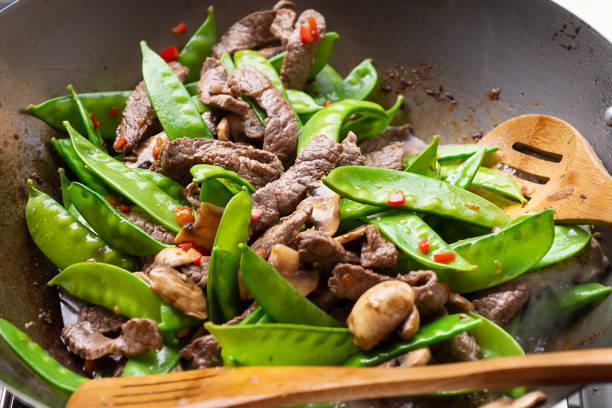 Stir-fried Beef and Snow Peas stock photo