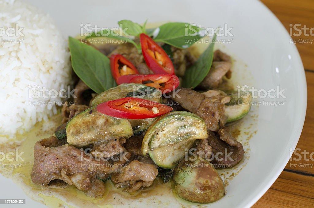 Stir-fried  green curry with pork stock photo