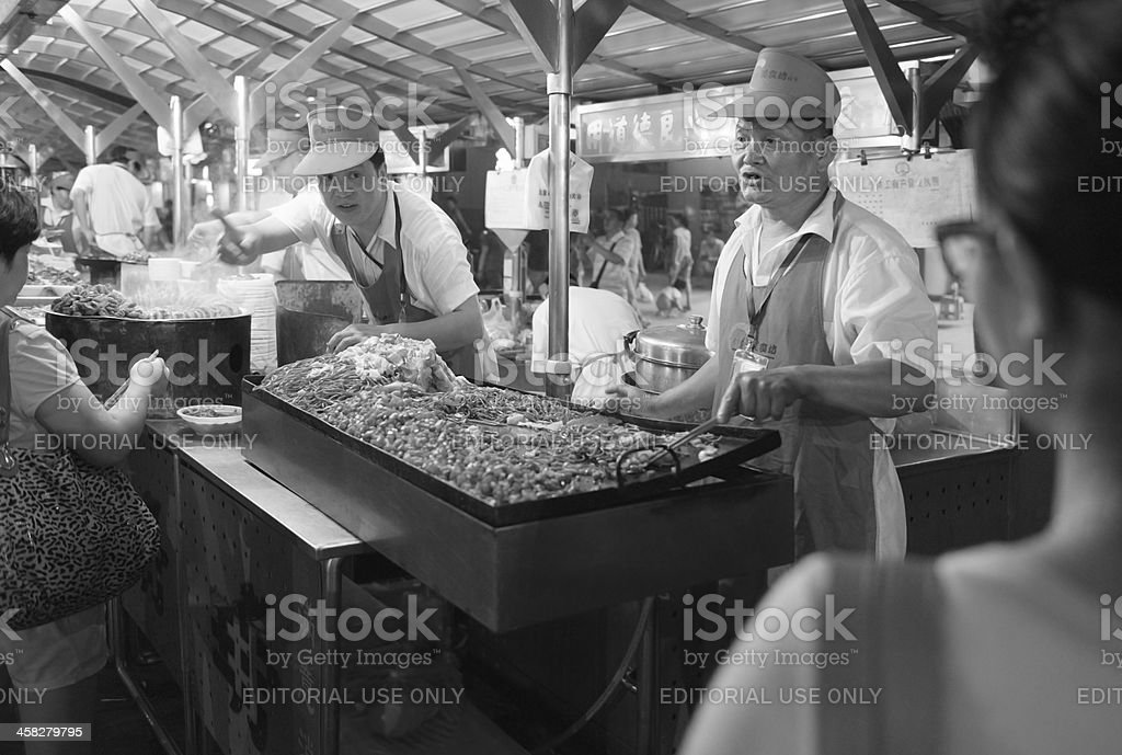 Stir-fried noodles with beef and vegetables at Beijing snack street royalty-free stock photo