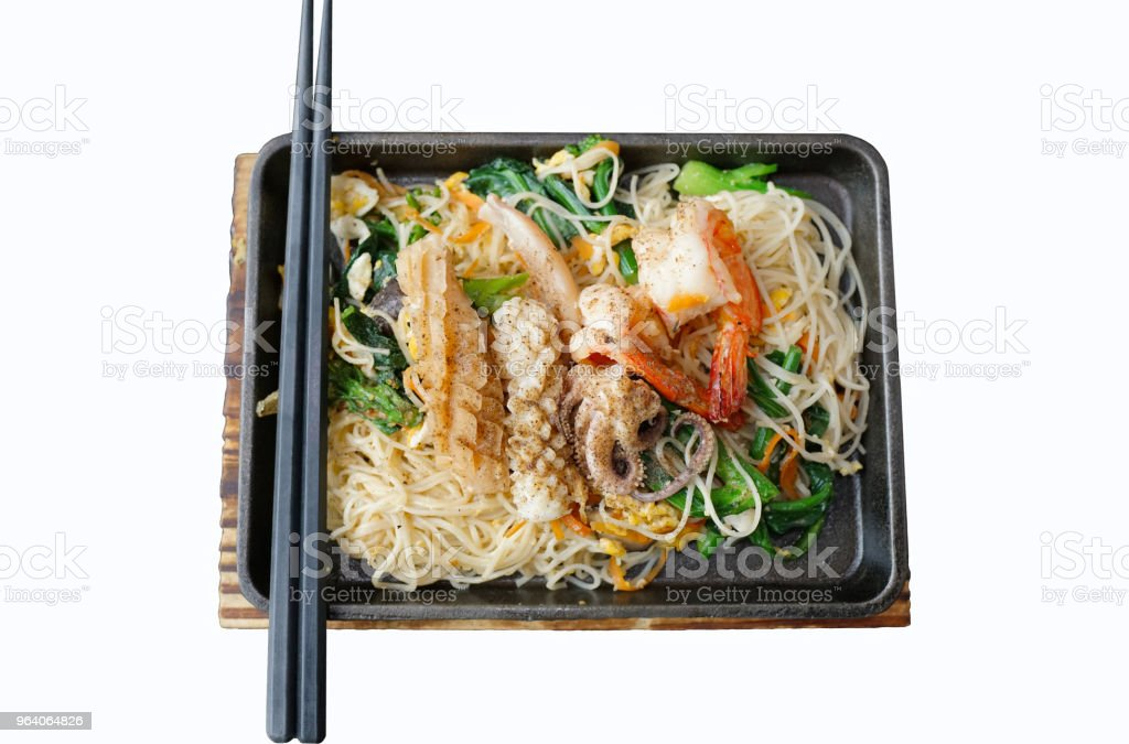 Stir-fried noodles with seafood isolated on white background - Royalty-free Calamari Stock Photo