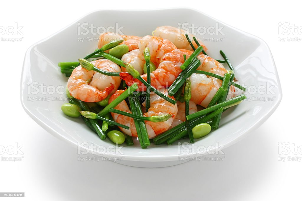 stir-fry flowering chinese chives with prawns and edamame stock photo