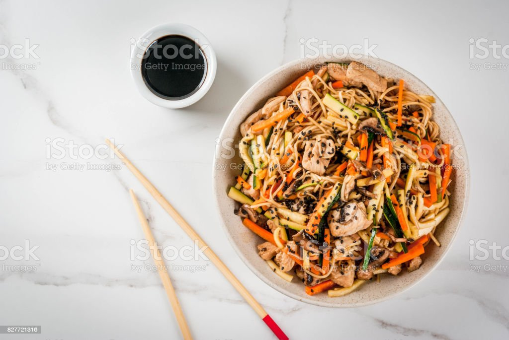 Stirfry with noodles, pork and vegetables stock photo