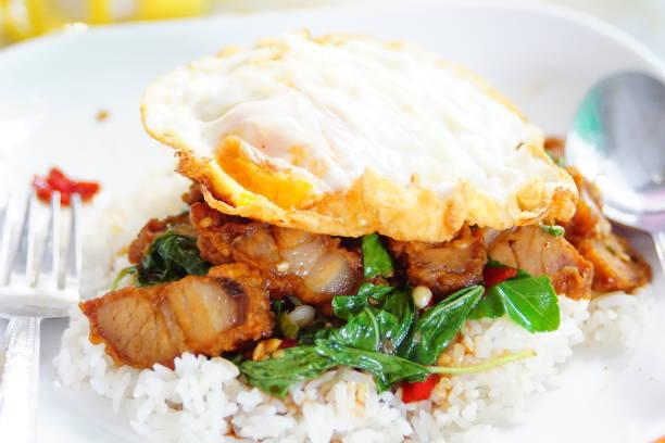 Stirred with crispy pork Thailand food stock photo