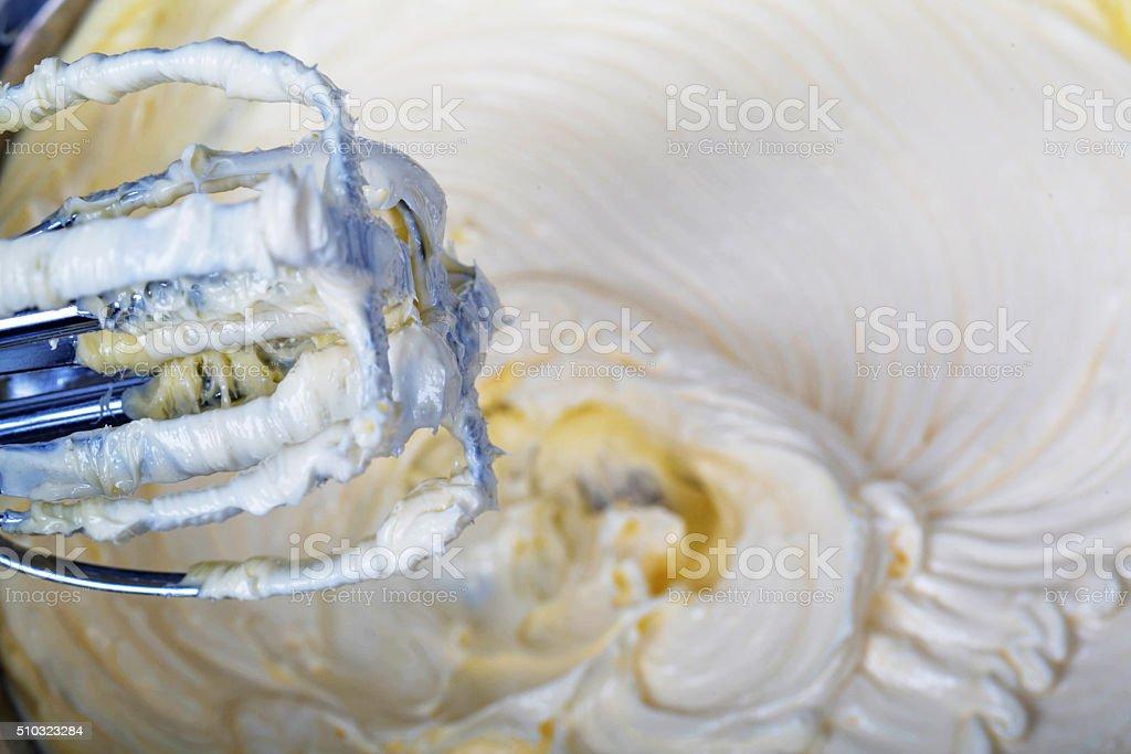 stirring butter cream stock photo