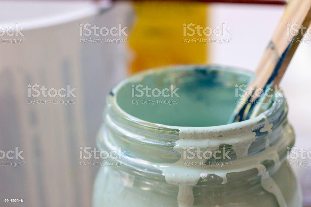 Stirring lightgreen and blue paint stock photo
