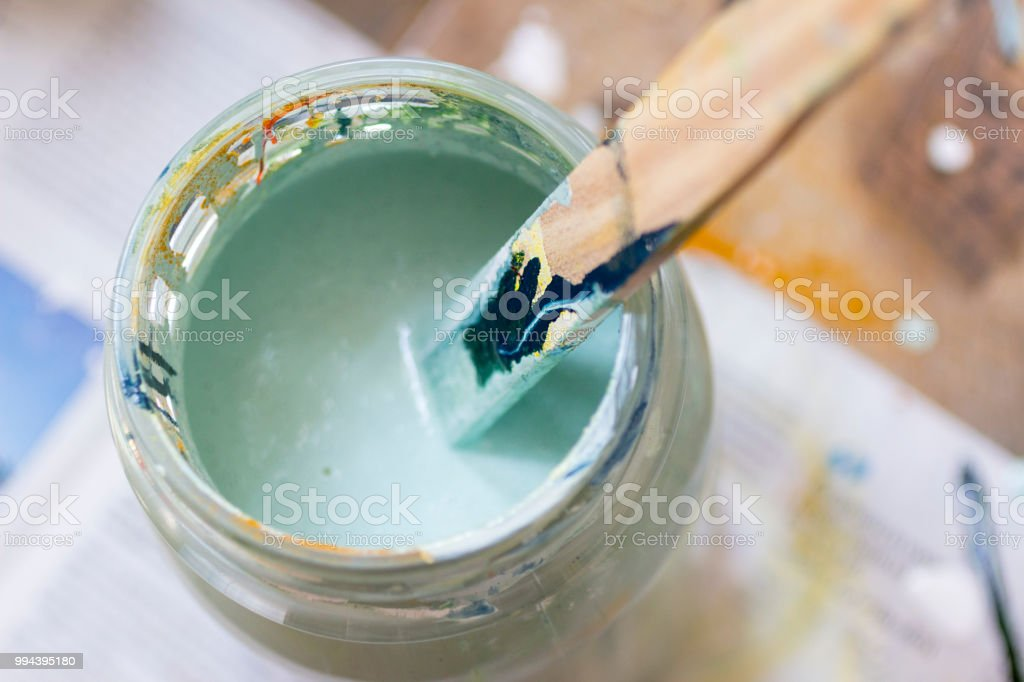 Stirring lightgreen paint stock photo