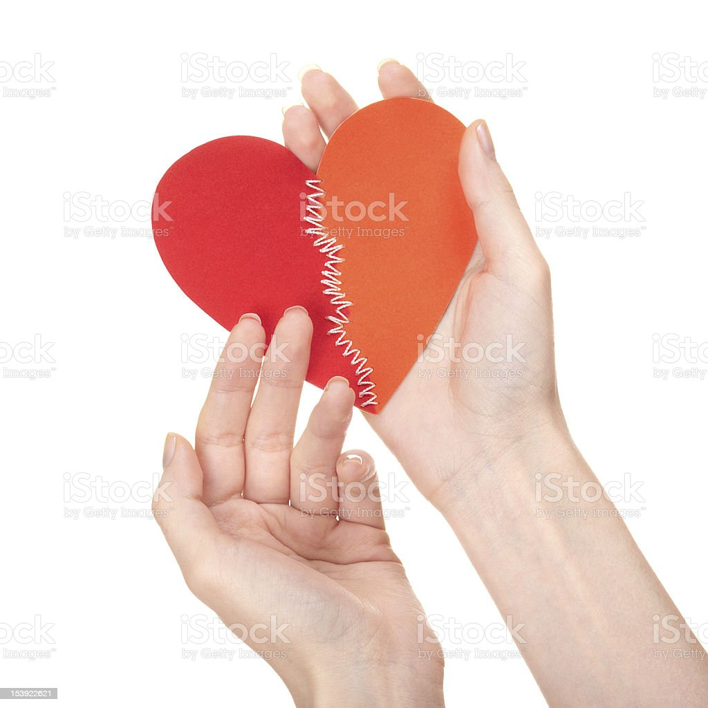Stitched broken heart in woman's hands royalty-free stock photo