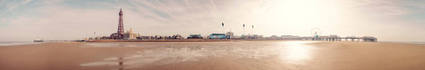 Stitched panorama of Blackpool from the beach at low tide on an unseasonably warm sunny February morning. stock photo
