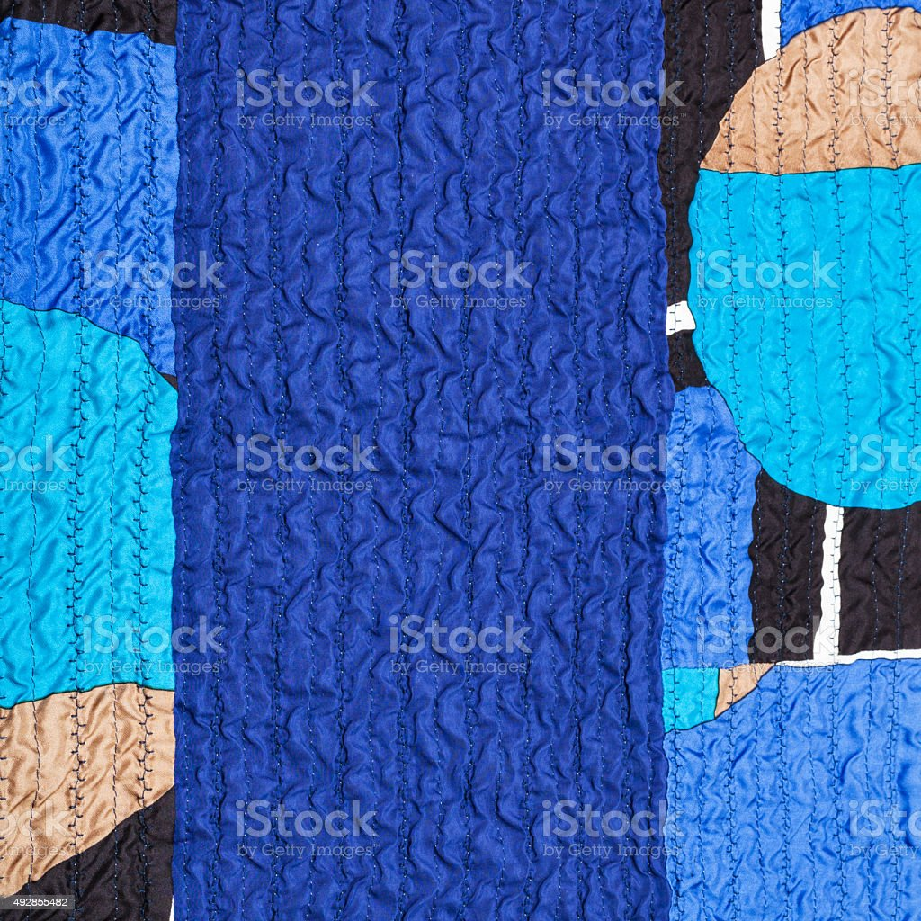 stitched wrinkled blue silk fabric and patchwork stock photo