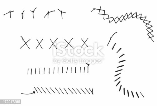 Various threaded stitches isolated on white.