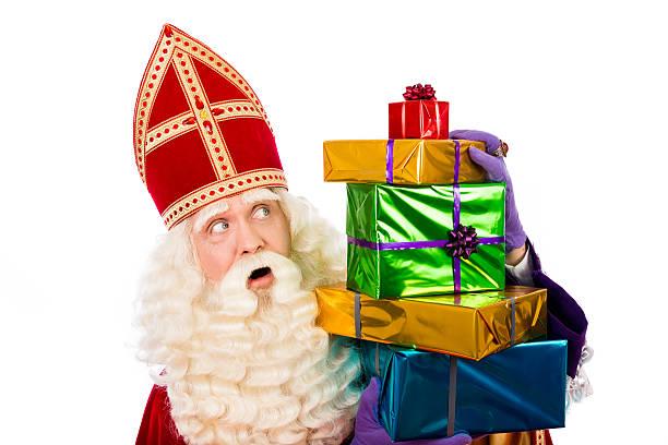 st.nicholas showing  gifts - cadeau sinterklaas stockfoto's en -beelden