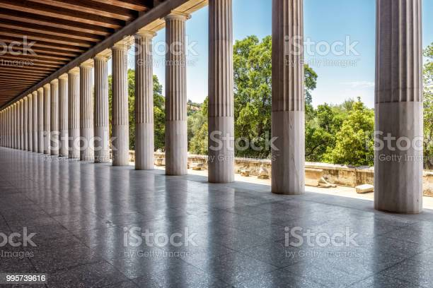 Stoa of Attalos in ancient Agora, Athens, Greece. It is one of the main tourist attractions of Athens. Panoramic view of Stoa columns with perspective. Restored historical architecture of Athens.