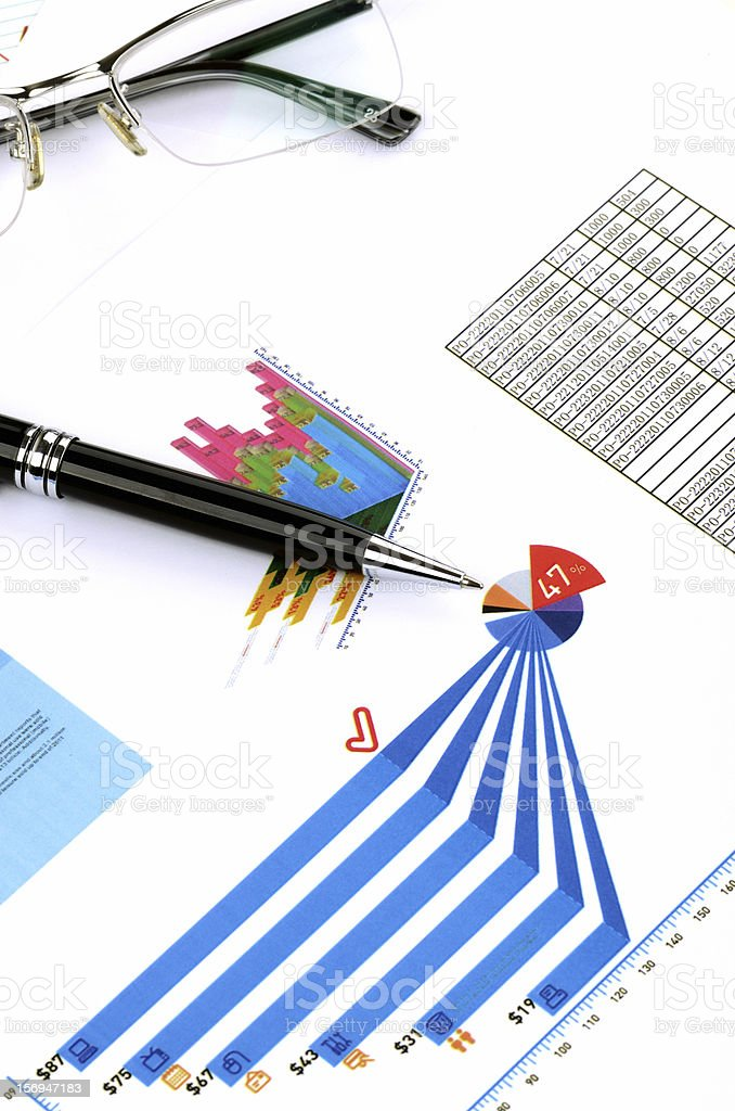 Stock chart with pen stock photo