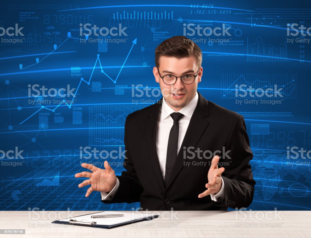 Stock data analyst in studio giving adivce on blue chart background stock photo