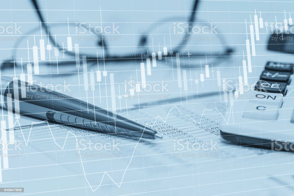 Stock data charts with spreadsheet calculator pen and glasses. Concept abstract photo of stock market financial bank accounting data analysis and monitoring. stock photo