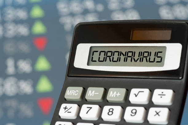 Stock exchange, calculator and coronavirus stock photo