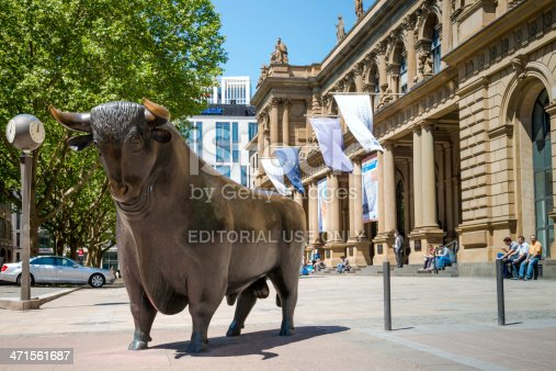 Frankfurt, Germany - June 6, 2013: Main entrance of the Frankfurt stock exchange of the Deutsche Boerse AG. The historic building is located in the city center. The bull in front of the Exchange
