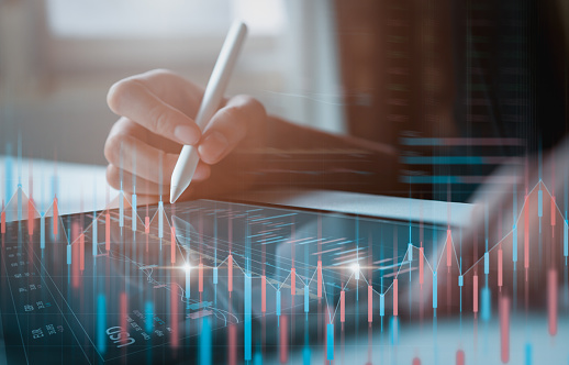 1044507110 istock photo Stock exchange market concept, businessman trader looking on tablet with graphs analysis candle line in office room, diagrams on screen. 1185329526