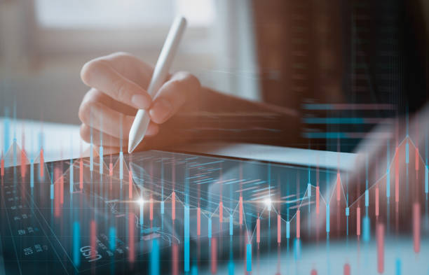 Stock exchange market concept, businessman trader looking on tablet with graphs analysis candle line in office room, diagrams on screen. stock photo