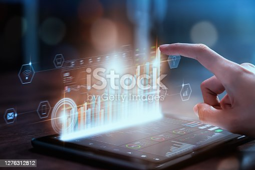 istock Stock exchange market concept, businesswoman hand trader press digital tablet with graphs analysis candle line on table in office, diagrams on screen. 1276312812