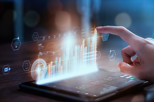 Stock exchange market concept, businesswoman hand trader press digital tablet with graphs analysis candle line on table in office, diagrams on screen.