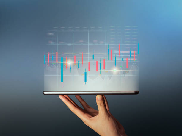 Stock exchange market concept, hand trader holding on digital tablet with graphs analysis candle line. stock photo