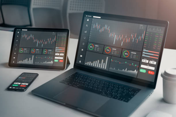 Stock exchange market concept, laptop and tablet, smartphone on the table with graphs analysis candle line in office room, diagrams on screen. stock photo