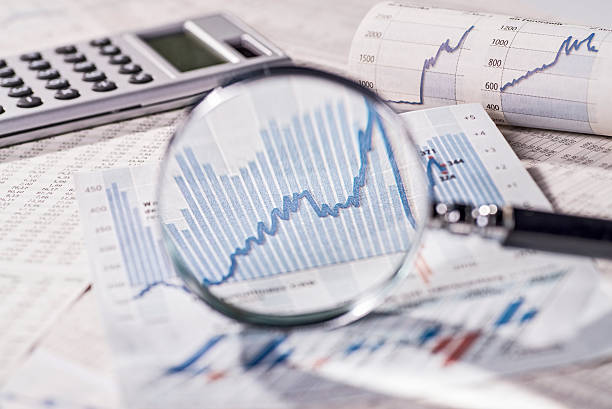 Stock exchange prices in the focus of a magnifier stock photo