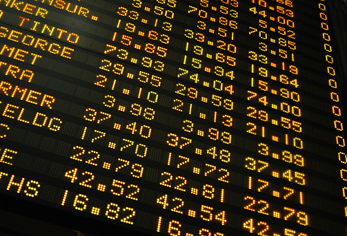 Stock Exchange Share Prices On An Electronic Display Board Stock Photo - Download Image Now