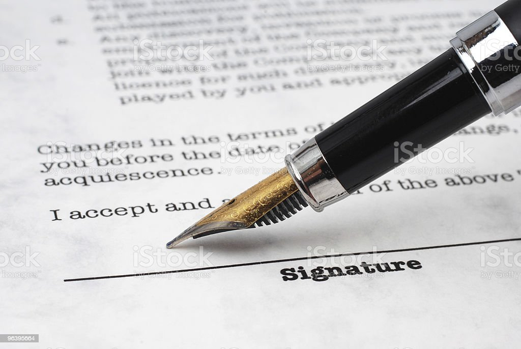 Stock image of a fountain pen about to sign a signature line - Royalty-free Agreement Stock Photo