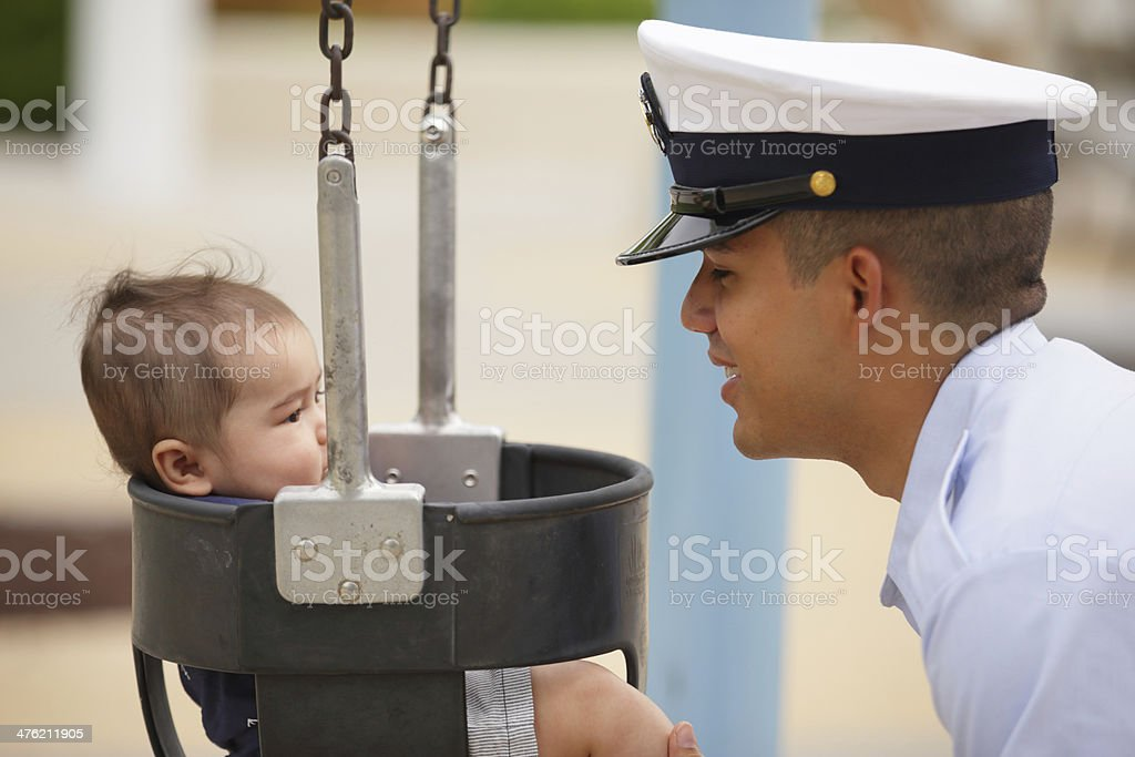 Stock image of a military man with his baby royalty-free stock photo