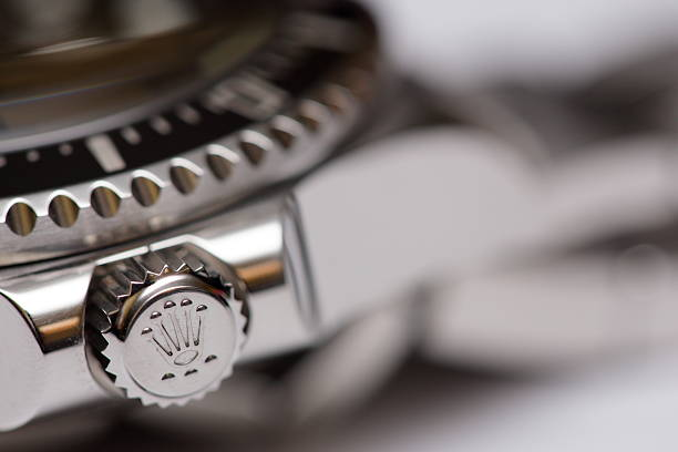 Stock image of a Rolex adjustment crown Hallandale, USA - May 16, 2014: Closeup image of a Rolex Deepsea adjustment crown in the locked position. luxury watch stock pictures, royalty-free photos & images