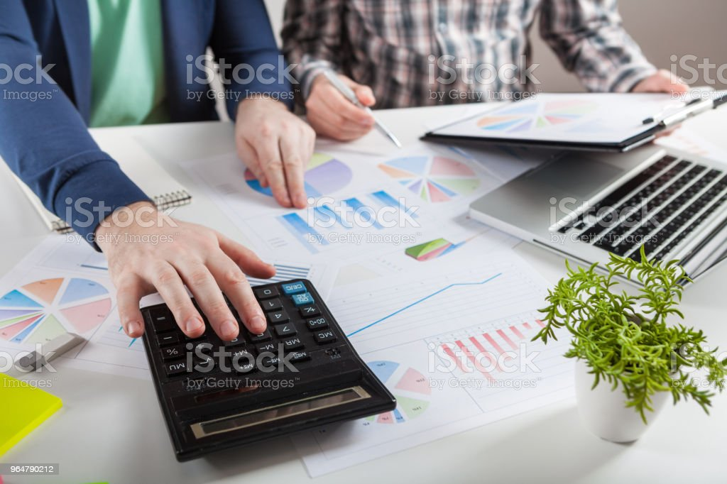 Stock market chart and finger pointing royalty-free stock photo
