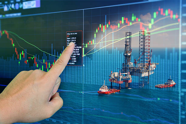 stock market concept with oil rig in the gulf - benzina foto e immagini stock