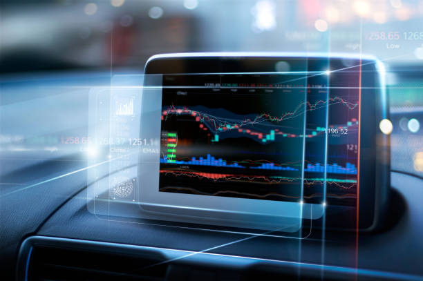 Stock market data display on virtual screen in the car on city background. Abstract finance design. Financial investment concept. stock photo