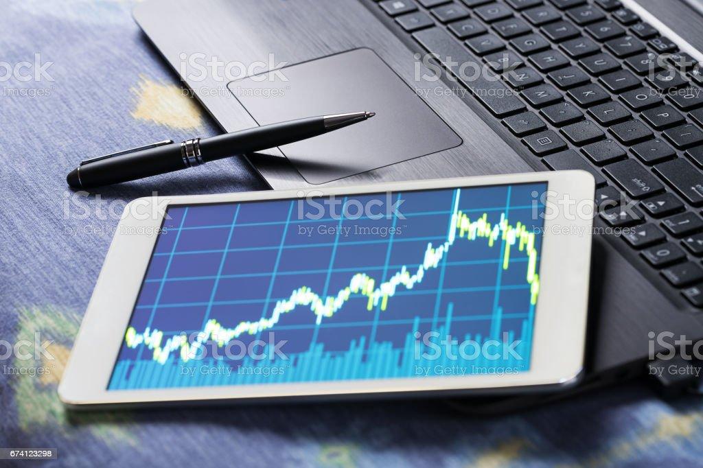 Stock market data on tablet pc stock photo