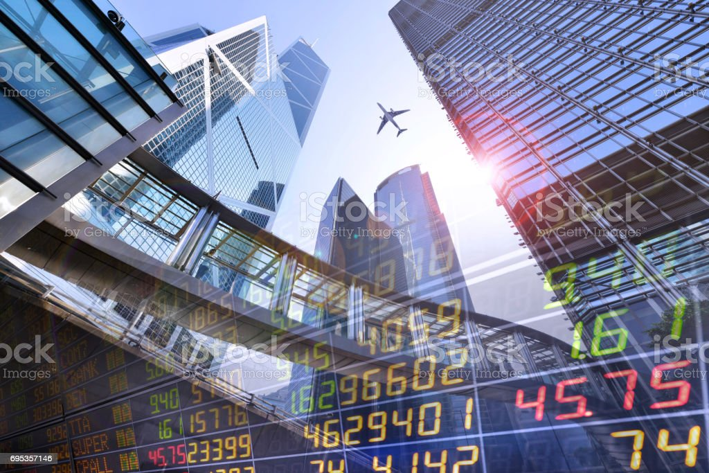 Stock Market Exchange on a skyscraper in Hong Kong background. stock photo