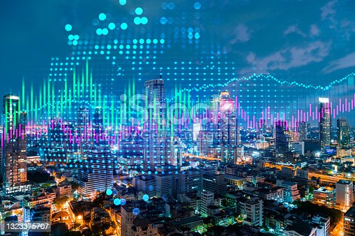 istock Stock market graph hologram, night panorama city view of Bangkok, popular location to gain financial education in Asia. The concept of international research. Double exposure. 1323375707