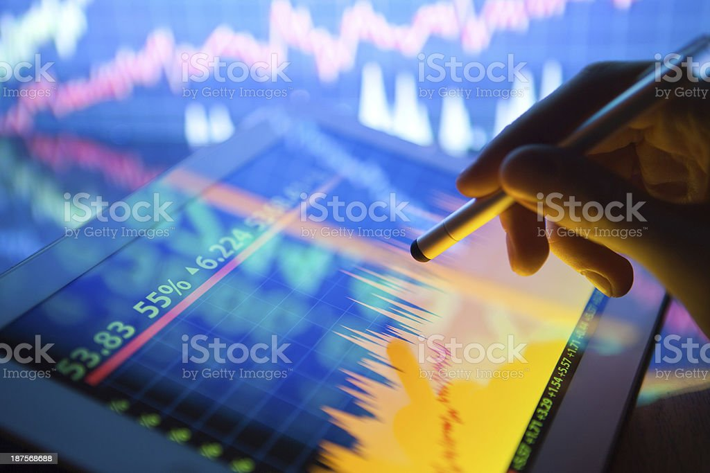 Stock market on digital tablet stock photo