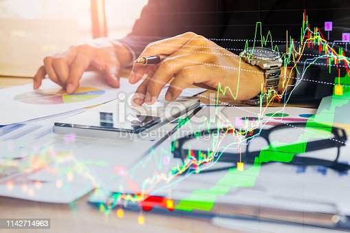 1140473216istockphoto Stock market or forex trading graph and candlestick chart suitable for financial investment concept. Economy trends background for business idea and all art work design. Abstract finance background. 1142714963