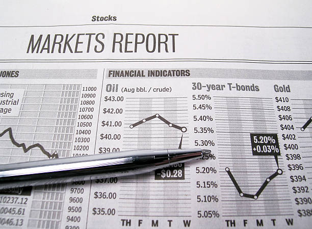 stock market page of newspaper with pen - new york stock exchange stock pictures, royalty-free photos & images